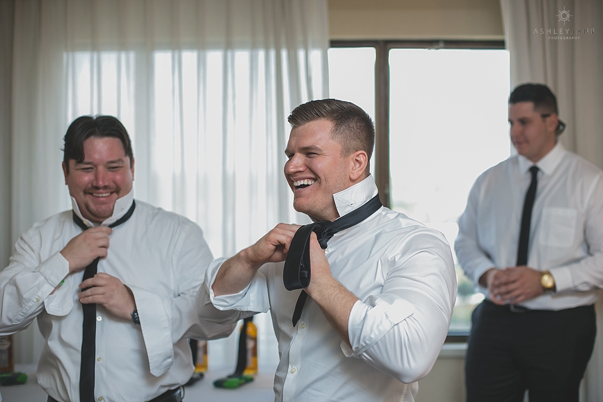 groom getting his tie on on his wedding day