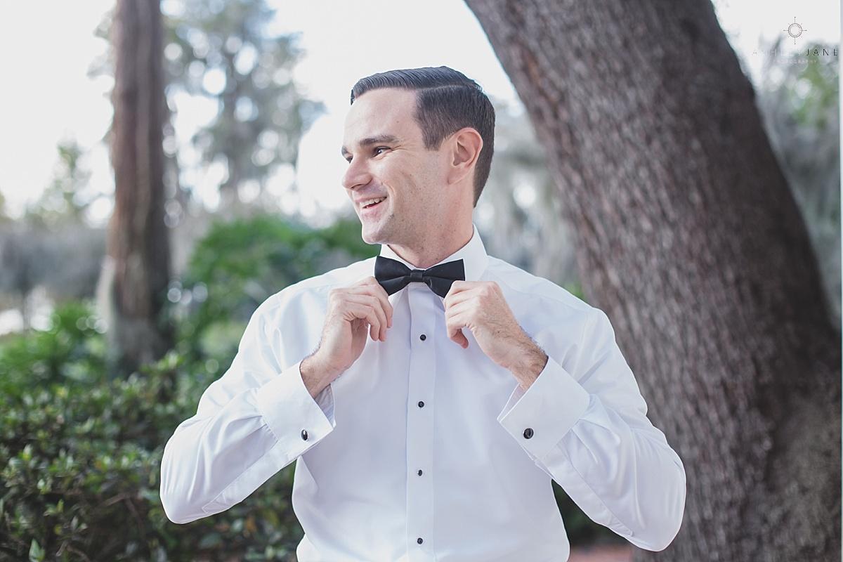 Elegant Rustic Cypress Grove Estate House Wedding| Groom getting ready on his wedding day black bow tie formal shot by orlando wedding photographer
