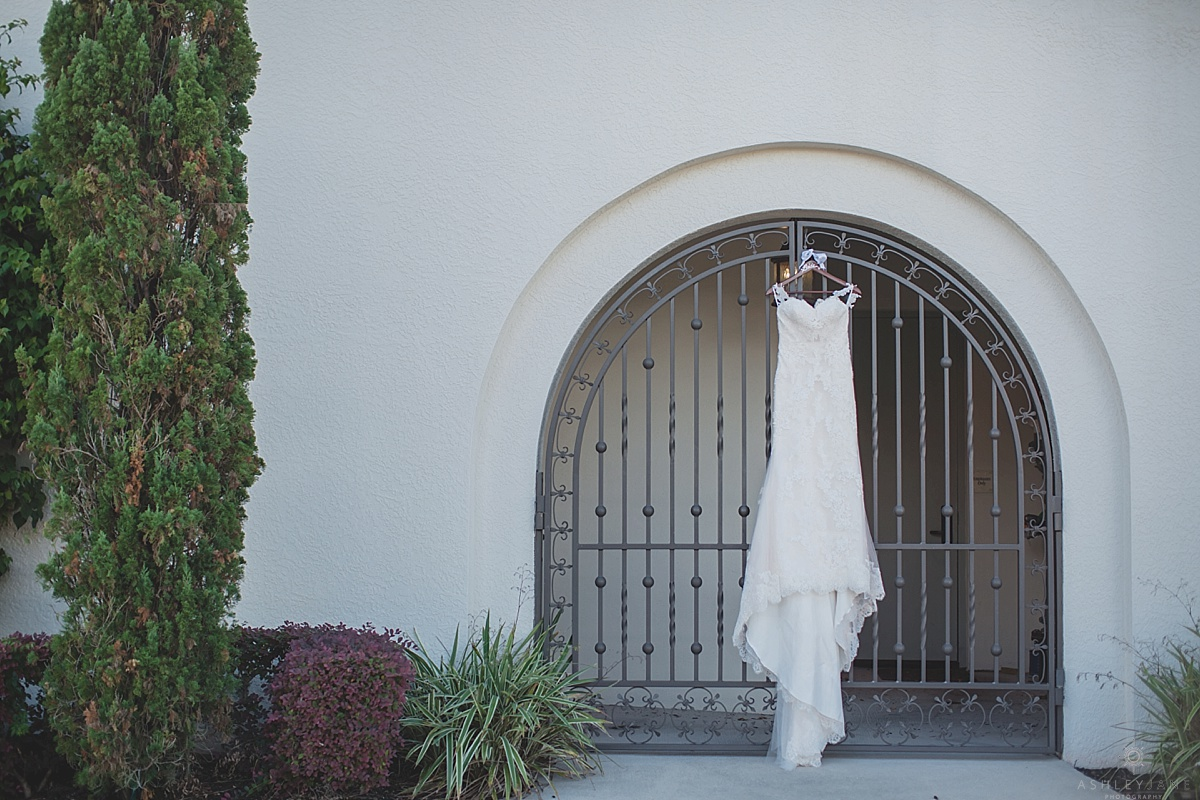Wedding dress hanging on spanish style building