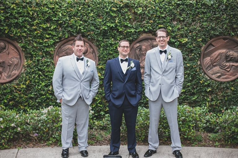 Groom in black suit and groomsmen in grey at Capen House Winter Park