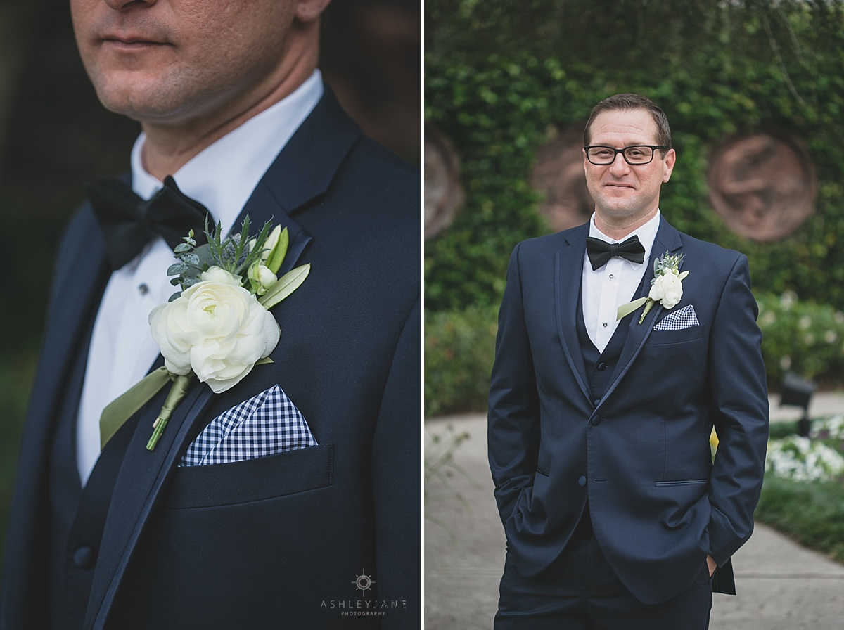 Black tux with white rose boutonniere