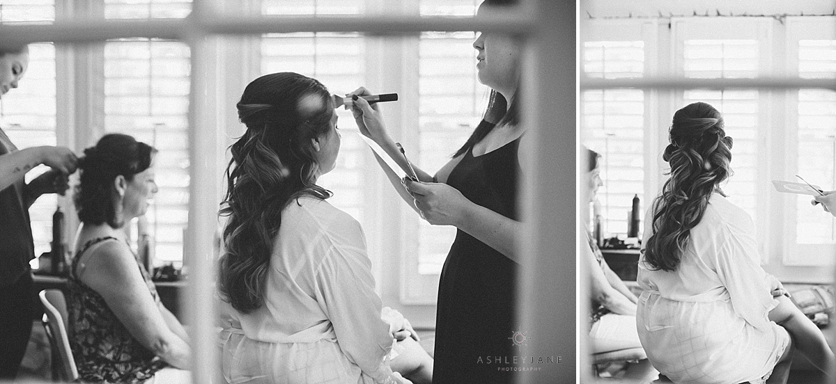 Bride getting made up on her wedding day shot by orlando wedding photographer