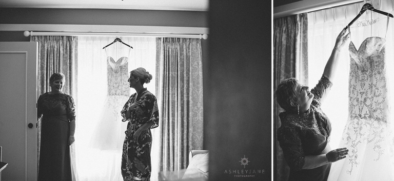 Bride getting dressed with her mom on her wedding day