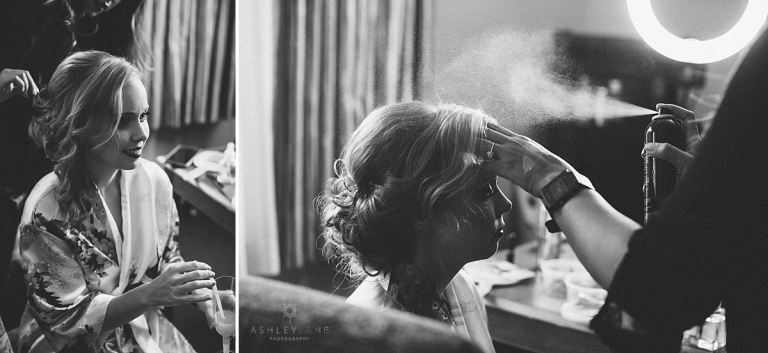 Bride getting her hair and makeup done in her floral robe
