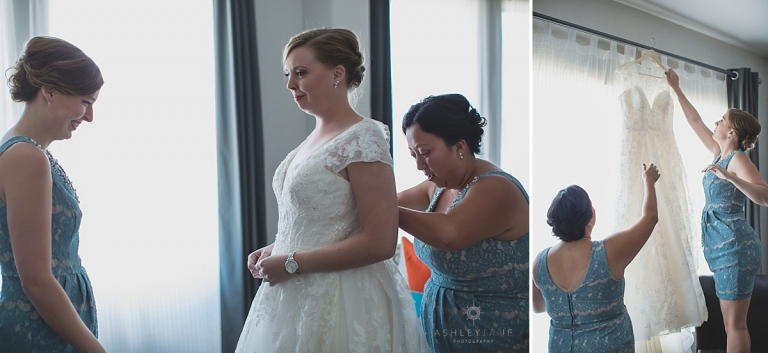 Bridesmaids helping the bride get dressed on her wedding day shot by orlando wedding photographer