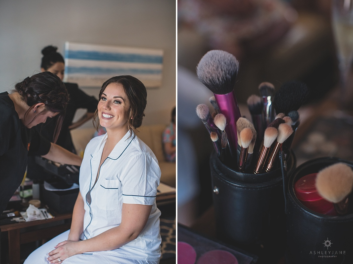 Bride is all smiles after getting her makeup done on wedding day