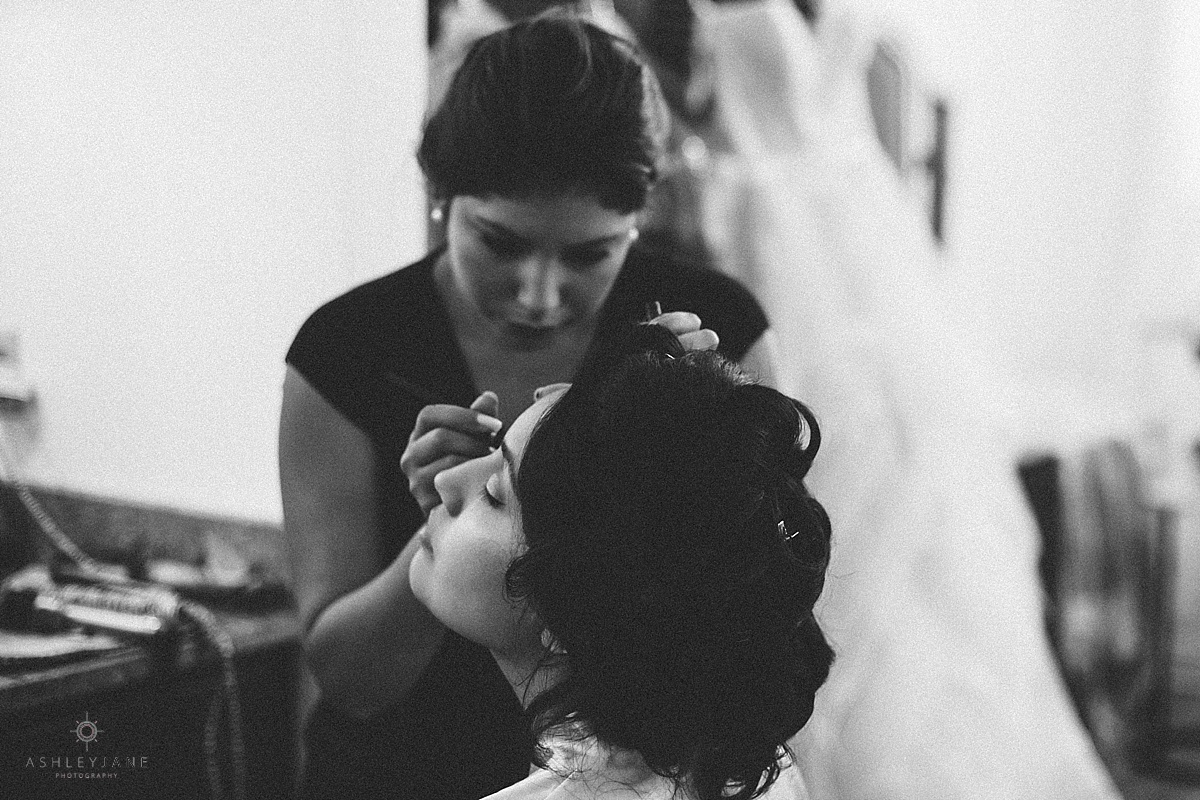 Romantic Blush Royal Crest Room Wedding | Bride getting her make up done on her wedding day shot by orlando wedding photographer