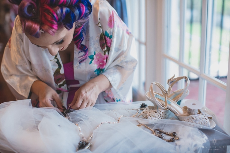 Alternative bride fixing her wedding day details at Luxmore Grande Estate by Orlando Wedding Photographer